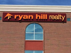 Real Estate Signs ryan hill realty storefront sign 300x225